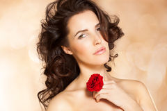 Beauty With Rose. Closeup of a beautiful woman with red rose Stock Images