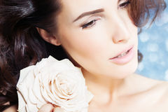 Beauty With Rose. Closeup of a beautiful woman with white rose Royalty Free Stock Images