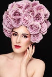 Beauty in rose's wig Stock Photography