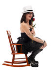 Beauty and the rose in a small chair Royalty Free Stock Image