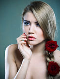 Beauty and roses Stock Image