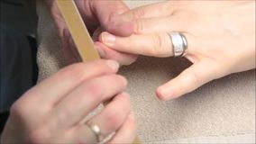 Beauty salon: Beautician performs manicures stock video footage