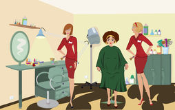 Beauty salon  client two salon workers. In red uniforms Royalty Free Stock Photo