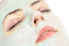 Beauty salon, closeup of facial mask applied. Beauty salon series, closeup of facial mask applied Royalty Free Stock Photo