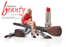 Beauty Salon. Concept. Beautiful blonde sitting on a makeup brush. Concept Royalty Free Stock Images