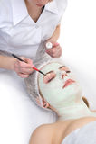 Beauty salon, eyes facial mask applying Stock Photography