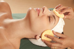 Beauty salon facial. Face cleansing and exfoliation, beauty salon treatment Stock Image