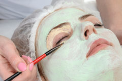 Beauty salon, facial mask applying Royalty Free Stock Photography