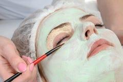 Beauty salon, facial mask applying Royalty Free Stock Photography