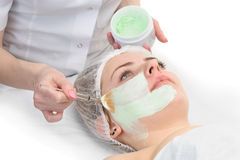 Beauty salon, facial mask applying Royalty Free Stock Images