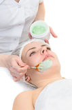 Beauty salon, facial mask applying Stock Images