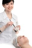 Beauty salon, facial mask applying Stock Photography