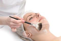 Beauty salon, facial mask applying Stock Photo