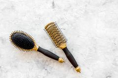 Beauty salon golden work tools with comb for hair dress and coloring on stone background top view mock up Stock Photos
