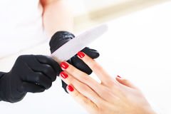 Beauty salon, hand care. Studio photography. The process of caring for the hands. Royalty Free Stock Photo