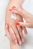 Beauty salon, hands massage with moisturizing Royalty Free Stock Photography