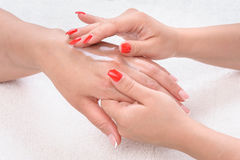 Beauty salon, hands massage with moisturizing Stock Photo