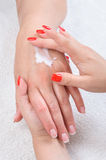 Beauty salon, hands massage with moisturizing Royalty Free Stock Images