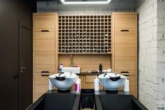 Beauty salon interior - hair washing sinks - white washbasins for hairdresser Stock Photo