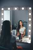 In the beauty salon. Make-up artist doing make-up, hairdresser doing hairstyle, beautiful models Royalty Free Stock Photography