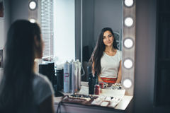 In the beauty salon. Make-up artist doing make-up, hairdresser doing hairstyle, beautiful models Royalty Free Stock Image