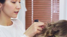 In the beauty salon, make-up artist doing make-up stock video footage
