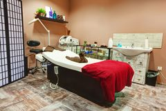 Beauty salon and massage interior. Beauty salon interior. Relaxing, zen design with table for treatment and massage Stock Photo