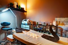 Beauty salon and massage interior. Relaxing, zen design. Beauty salon interior. Relaxing, zen design with table for treatment and massage Stock Image