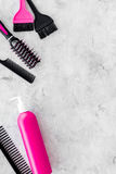 Beauty salon pink work tools with comb for hair dress and coloring on stone background top view mock up Royalty Free Stock Images