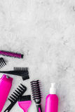 Beauty salon pink work tools with comb for hair dress and coloring on stone background top view mock up Royalty Free Stock Photos