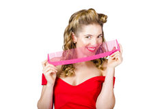 Beauty salon pinup girl smiling with haircare comb Royalty Free Stock Photography