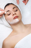 Beauty salon series. Cleaning off the facial mask Royalty Free Stock Photography