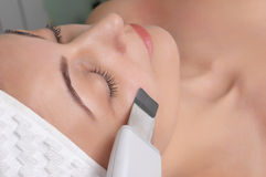 Beauty salon series. Woman getting ultrasound skin cleaning at beauty salon Royalty Free Stock Photos