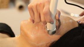 Beauty salon series. Beauty treatment, girl closeup hd stock video