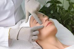 Beauty salon series. facial massage Stock Photos