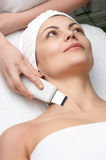 Beauty salon series, ultrasound skin cleaning Stock Photos