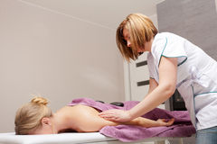 Beauty salon. Woman getting spa hot stone therapy massage Royalty Free Stock Image