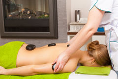 Beauty salon. Woman getting spa hot stone therapy massage Stock Photo