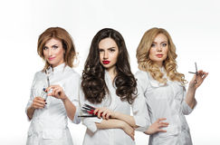 Beauty salon workers with professional tools Stock Images