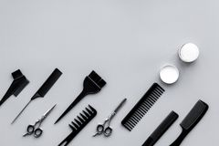 Beauty saloon equipment. Hairdress, haircut. Combs, sciccors, brushes on grey background top view copy space royalty free stock photo