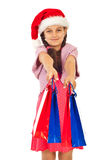 Beauty Santa girl offering shopping bags Royalty Free Stock Image
