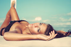 Beauty by the sea. Beauty shot of young woman on the beach Stock Image