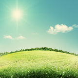 Beauty seasonal backgrounds with green hills Stock Image