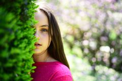 Beauty secrets. Skincare products and natural skin cosmetics. Young lady in spring garden. Cute girl on spring landscape. Pretty girl with young face skin and royalty free stock photos