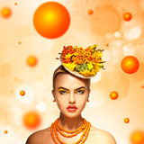Beauty serious girl with rowan hairstyle orange background Royalty Free Stock Photography