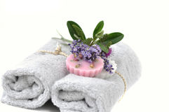 Beauty session. Two towels with lavender and rose soap stock photo