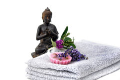 Beauty session. Two towels with lavender and rose soap and a buddha stock photos