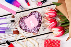 Beauty set, card and flowers. How to congratulate woman Royalty Free Stock Photo