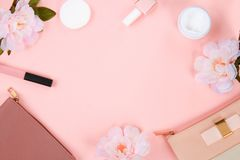 Beauty set with decorative cosmetics. nail polish, brushes and bag on pink background top view mockup. stock photos