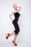 Beauty sexy blond woman in skinny black dress pinup perfect body Stock Images